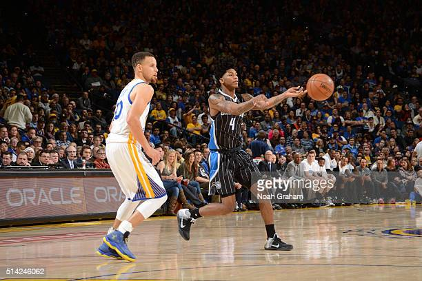 Elfrid Payton of the Orlando Magic passes against Stephen Curry of the Golden State Warriors on March 7 2016 at Oracle Arena in Oakland California...