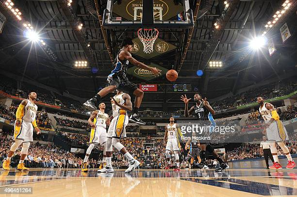 Elfrid Payton of the Orlando Magic passes the ball to Dewayne Dedmon of the Orlando Magic during the game against the Indiana Pacers on November 9...