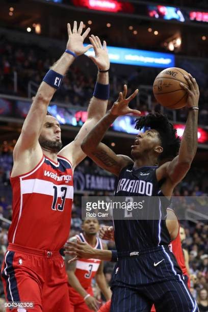 Elfrid Payton of the Orlando Magic puts up a shot in front of Marcin Gortat of the Washington Wizards in the first half at Capital One Arena on...