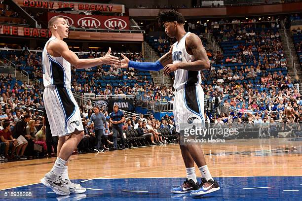 Elfrid Payton of the Orlando Magic shakes hands with Aaron Gordon of the Orlando Magic during the game against the Memphis Grizzlies on April 3 2016...
