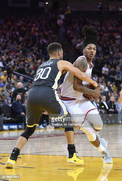 Elfrid Payton of the Phoenix Suns drives to the basket and gets fouled by Stephen Curry of the Golden State Warriors during an NBA basketball game at...