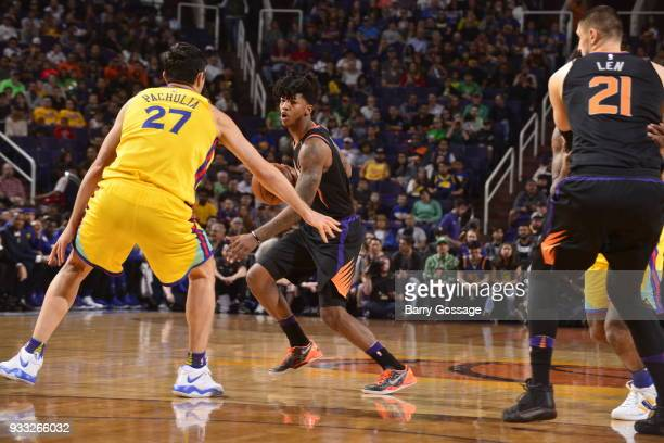 Elfrid Payton of the Phoenix Suns handles the ball against the Golden State Warriors on March 17 2018 at Talking Stick Resort Arena in Phoenix...