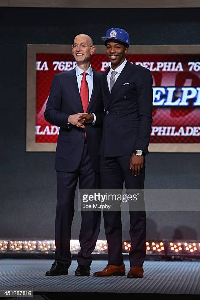 Elfrid Payton shakes hands with NBA Commissioner Adam Silver after being selected number ten overall by the Philadelphia 76ers during the 2014 NBA...