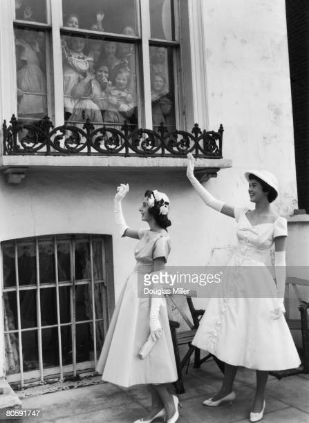 Elfrida Eden niece of Sir Anthony Eden and her friend Alexandra Versen leave Victoria Road in Kensington for a presentation party at Buckingham...