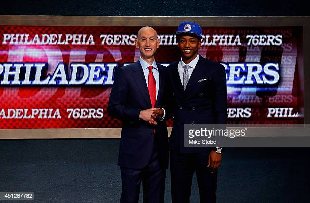 Elfried Payton of LouisianaLafayette shakes hands with NBA Commissioner Adam Silver after being drafted with the overall pick by the Philadelphia...