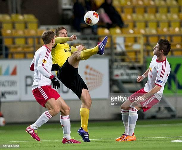Elfsborg's Anders Svensson vies with Salzburg's Florian Klein and Valon Berisha during the UEFA Europa League Group C football match IF Elfsborg vs...