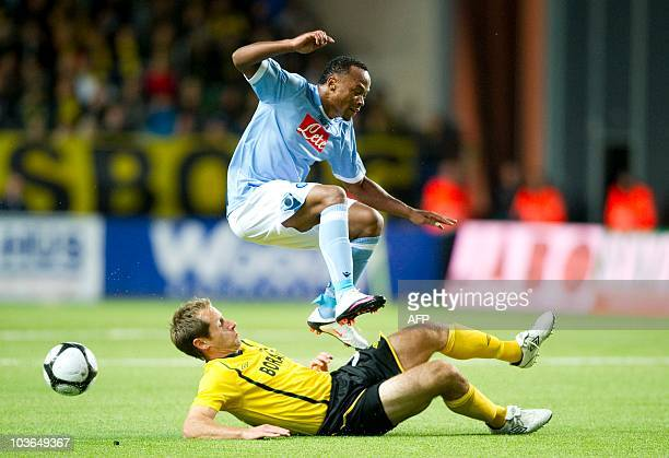 Elfsborg's Camilo Zuniga sloides under Napoli's Johan Karlsson in the Europa League match between IF Elfsborg and SSC Napoli at the Behrn Arena in...