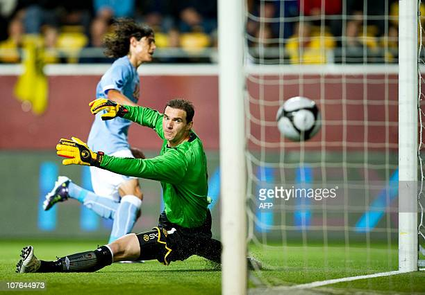 Elfsborg's goalkeeper Ante Covic watches the ball sail past him and into the goal as Napoli's Edison Cavanis scores his team's second goal in their...