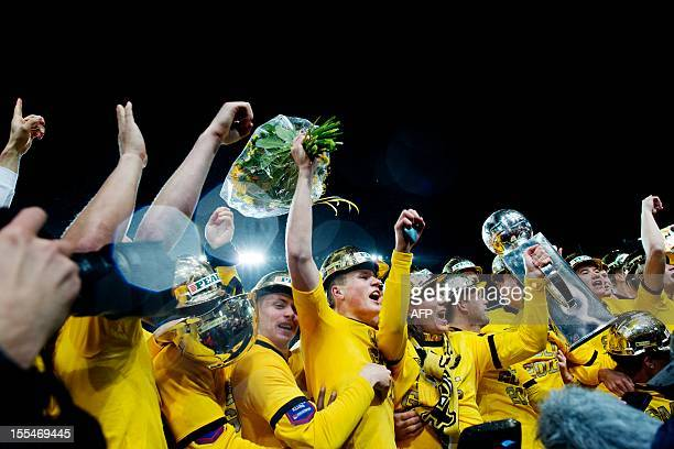 Elfsborg's players celebrate with the trophy after becoming Swedish champions following a 1-1 draw with Atvidabergs FF in the Swedish soccer league...
