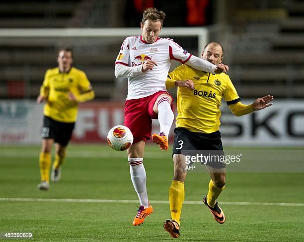 Elfsborg's Swedish defender Stefan Larsson and Salzburg's midfielder Marco Meilinger vie for the ball during the UEFA Europa League Group C football...