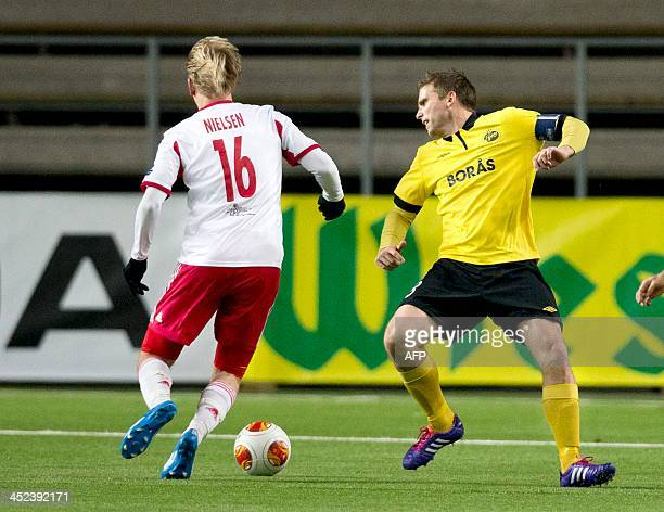 Elfsborg's Swedish midfielder Anders Svensson and Salzburg's Norwegian striker Havard Nielsen vie for the ball during the UEFA Europa League Group C...