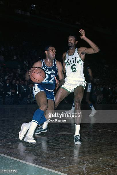 Elgin Baylor of the Los Angeles Lakers drives the ball up court against Bill Russell of the Boston Celtics during a game played in 1963 at the Boston...