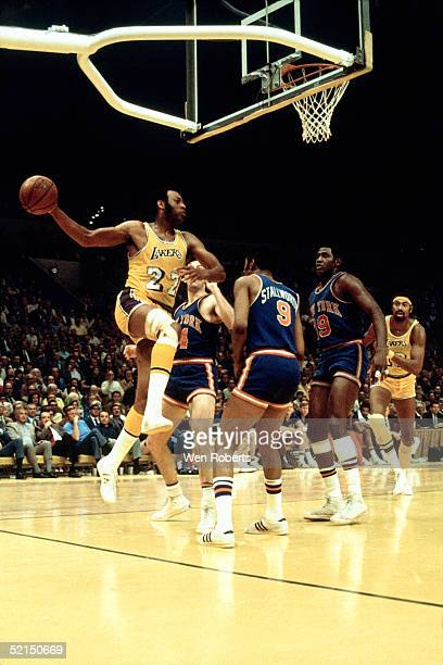 Elgin Baylor of the Los Angeles Lakers looks to pass against the New York Knicks during an NBA game at the Great Western Forum in 1970 in Inglewood...