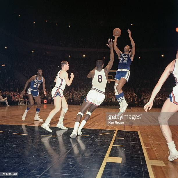 Elgin Baylor of the Los Angeles Lakers takes a jump shot against the New York Knicks during the NBA game at Madison Square Garden circa 1967 in New...