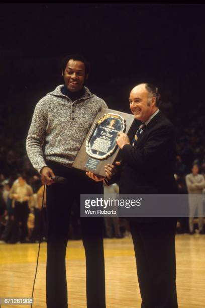 Elgin Baylor of the West receives an award from J Walter Kennedy during the 1972 NBA AllStar Game on January 18 1972 at The Forum in Inglewood...