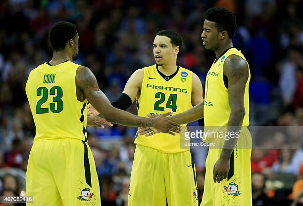 Elgin Cook Dillon Brooks and Jordan Bell of the Oregon Ducks celebrate their 79 to 73 win over the Oklahoma State Cowboys during the second round of...