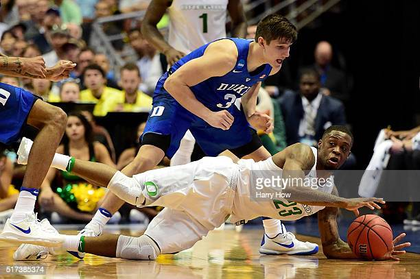 Elgin Cook of the Oregon Ducks dives on the ball against Grayson Allen of the Duke Blue Devils in the second half in the 2016 NCAA Men's Basketball...