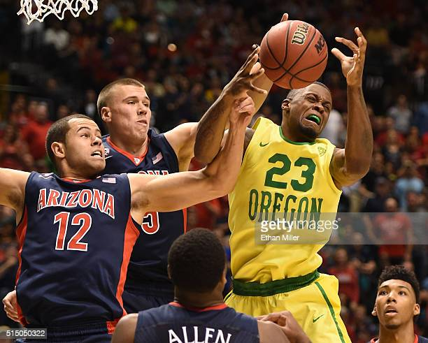 Elgin Cook of the Oregon Ducks goes up for a rebound against Ryan Anderson Kaleb Tarczewski Kadeem Allen and Allonzo Trier of the Arizona Wildcats...