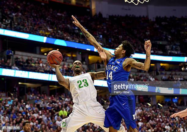 Elgin Cook of the Oregon Ducks goes up for a shot against Brandon Ingram of the Duke Blue Devils in the first half in the 2016 NCAA Men's Basketball...