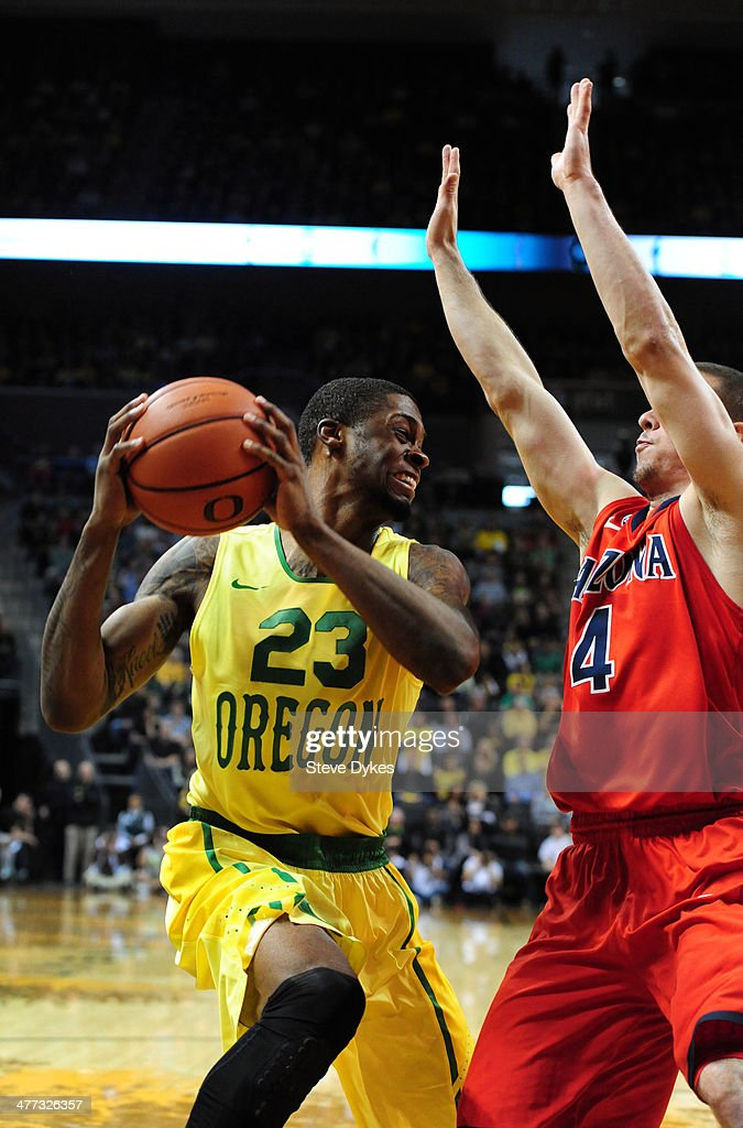 Elgin Cook #23 of the Oregon Ducks tries to get around T.J. McConnell #4 of the Arizona Wildcats during the first half of the game at Matthew Knight Arena on March 8, 2014 in Eugene, Oregon.
