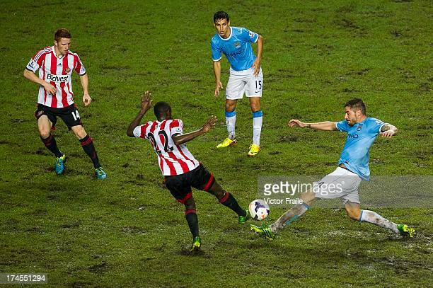 ElHadji Ba of Sunderland and Javi Garcia of Manchester City fight for the ball during the Barclays Asia Trophy Final match between Manchester City...
