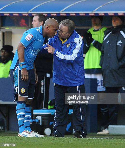 ElHadji Diouf of Leeds has a word with manager Neil Warnock during the npower Championship match between Millwall and Leeds United at The New Den on...
