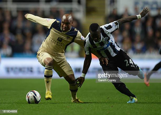 ElHadji Diouf of Leeds United battles with Cheik Ismael Tiote of Newcastle United during the Capital One Cup Third Round match between Newcastle...