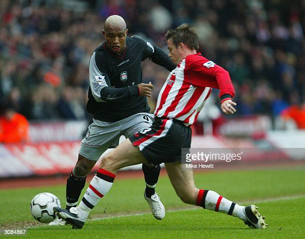 ElHadji Diouf of Liverpool tries to get past Graeme Le Saux of Southampton during the FA Barclaycard Premiership match between Southampton and...
