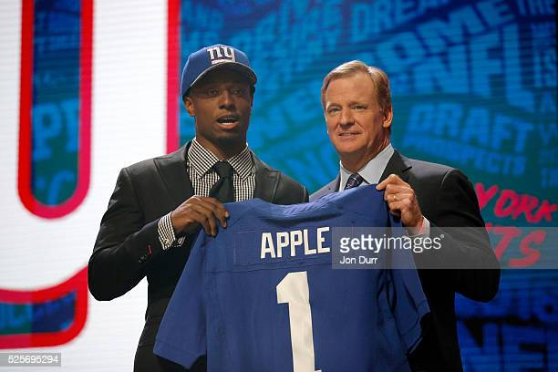 Eli Apple of Ohio State holds up a jersey with NFL Commissioner Roger Goodell after being picked overall by the New York Giants during the first...