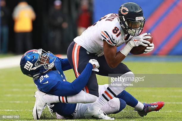 Eli Apple of the New York Giants tackles Cameron Meredith of the Chicago Bears during the second half at MetLife Stadium on November 20 2016 in East...