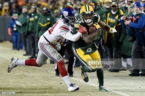 Eli Apple of the New York Giants tackles Davante Adams of the Green Bay Packers in the fourth quarter during the NFC Wild Card game at Lambeau Field...