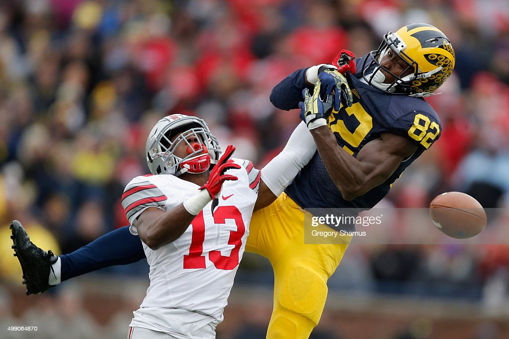 Eli Apple #13 of the Ohio State Buckeyes breaks up a pass intended for Amara Darboh #82 of the Michigan Wolverines in the first half at Michigan Stadium on November 28, 2015 in Ann Arbor, Michigan.