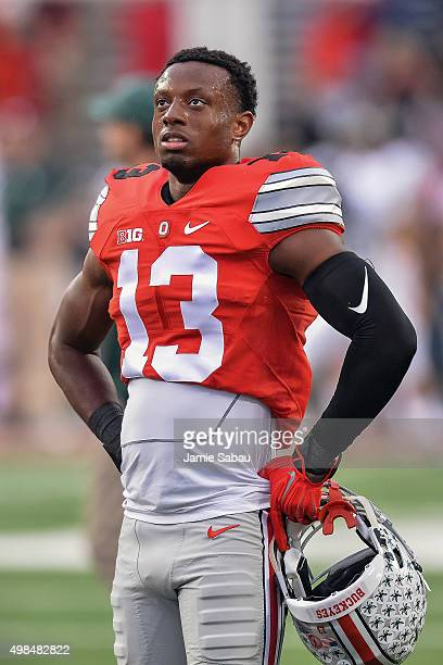 Eli Apple of the Ohio State Buckeyes stands on the field during pregame warm up before a game against the Michigan State Spartans at Ohio Stadium on...