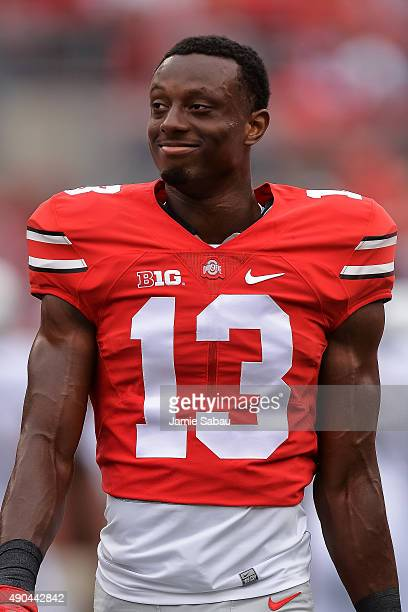 Eli Apple of the Ohio State Buckeyes takes a breather before a game against the Western Michigan Broncos at Ohio Stadium on September 26 2015 in...