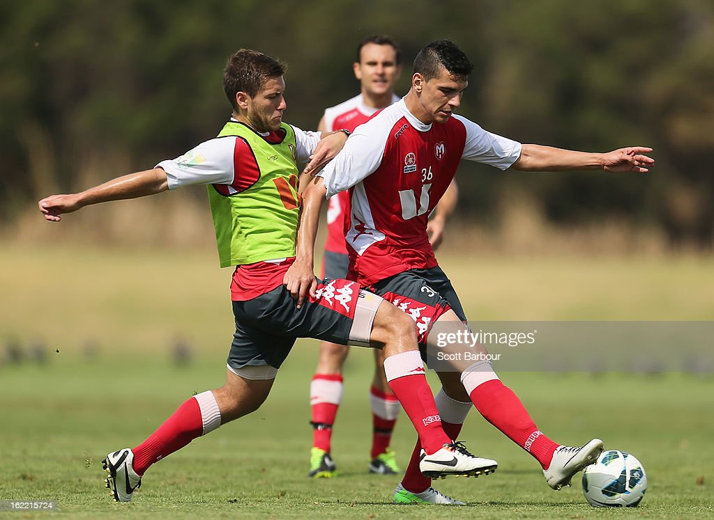 Eli Babalj and David Vrankovic (L) of the Heart compete for the ball during a Melbourne Heart A-League training session at La Trobe University Sports Fields on February 21, 2013 in Melbourne, Australia.