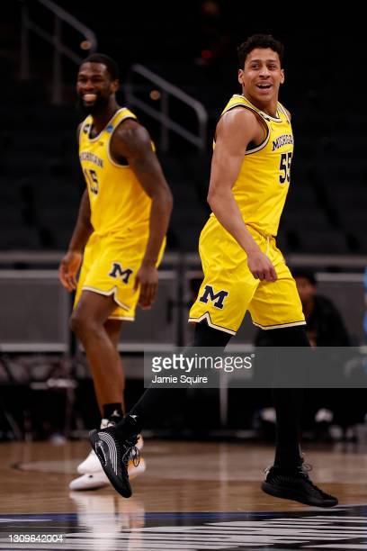 Eli Brooks of the Michigan Wolverines reacts after a three point basket against the Florida State Seminoles in the second half of their Sweet Sixteen...