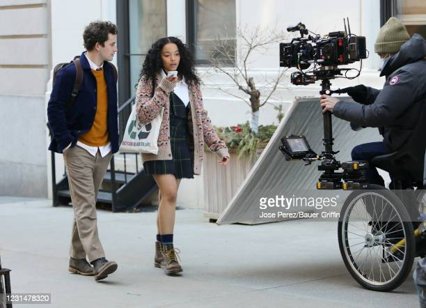 """Eli Brown and Whitney Peak are seen on the set of """"Gossip Girl"""" on March 02, 2021 in New York City."""