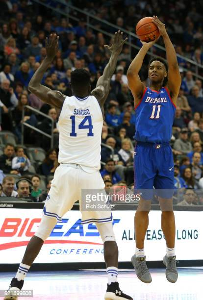 Eli Cain of the DePaul Blue Demons in action as Ismael Sanogo of the Seton Hall Pirates defends during a game at Prudential Center on February 18...