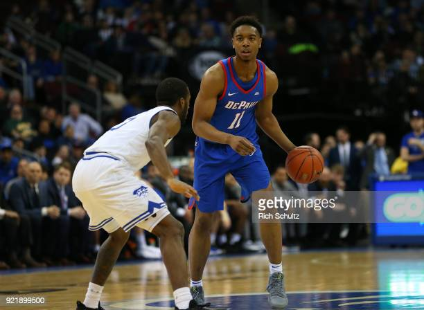 Eli Cain of the DePaul Blue Demons in action as Khadeen Carrington of the Seton Hall Pirates defends during a game at Prudential Center on February...