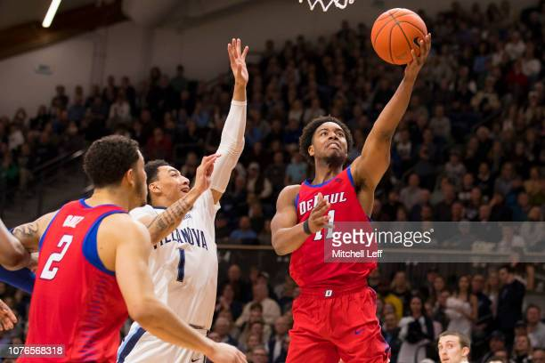 Eli Cain of the DePaul Blue Demons shoots the ball against Jahvon Quinerly of the Villanova Wildcats in the second half at Finneran Pavilion on...