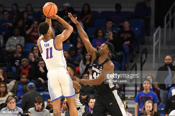 Eli Cain of the DePaul Blue Demons takes a shot over Isaiah Jackson of the Providence Friars during a college basketball game at Wintrust Arena on...
