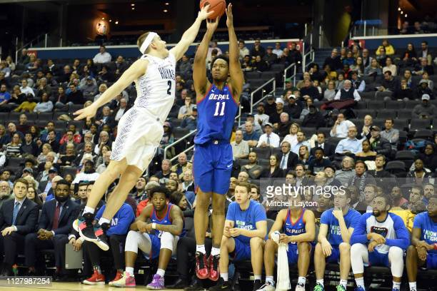 Eli Cain of the DePaul Blue Demons takes a shot over Mac McClung of the Georgetown Hoyas oil the second half during a college basketball game at the...