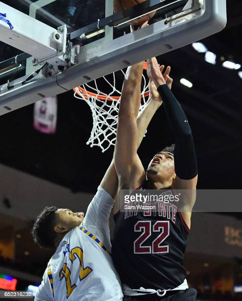 Eli Chuha of the New Mexico State Aggies goes up for a layup against Moataz Aly of the Cal State Bakersfield Roadrunners during the championship game...