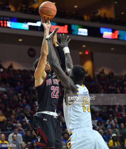 Eli Chuha shoots against Fallou Ndoye of the Cal State Bakersfield Roadrunners during the championship game of the Western Athletic Conference...