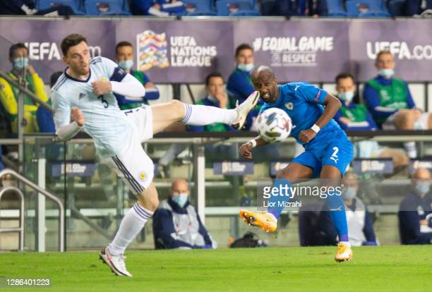 Eli Dasa of Israel challenge Andy Robertson of Scotland during the UEFA Nations League group stage match between Israel and Scotland at Netanya...