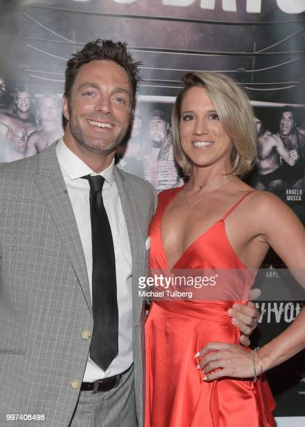 Eli Drake and guest attend a screening of the pro wrestling documentary '350 Days' at TCL Chinese 6 Theatres on July 12 2018 in Hollywood California