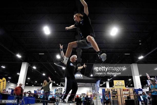 DENVER CO NOVEMBER 12 Eli Ellis in front and Damon Dutton in back show off their impressive skills on slacklines from Slacklines Industries on...