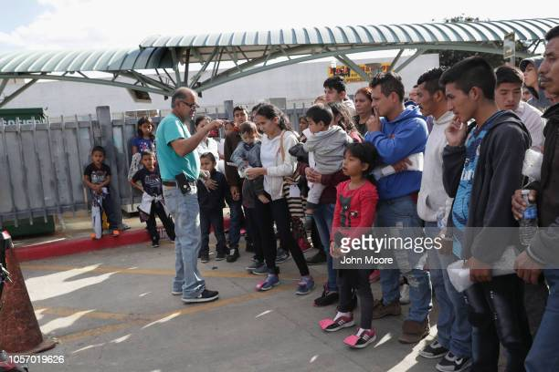 Eli Fernandez, a volunteer for Catholic Charities, speaks to immigrants, most seeking political asylum, who were released from U.S. Government...