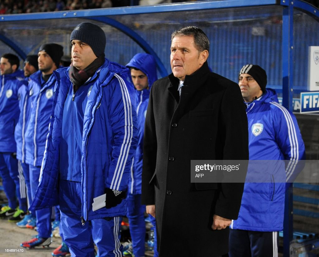 Eli Guttman (R) manager of Israel in the dugout during the FIFA 2014 World Cup qualifying football match between Northern Ireland and Israel at Windsor Park in Belfast, Northern Ireland on March 26, 2013. Israel won the game 2-0. AFP PHOTO/MICHAEL COOPER