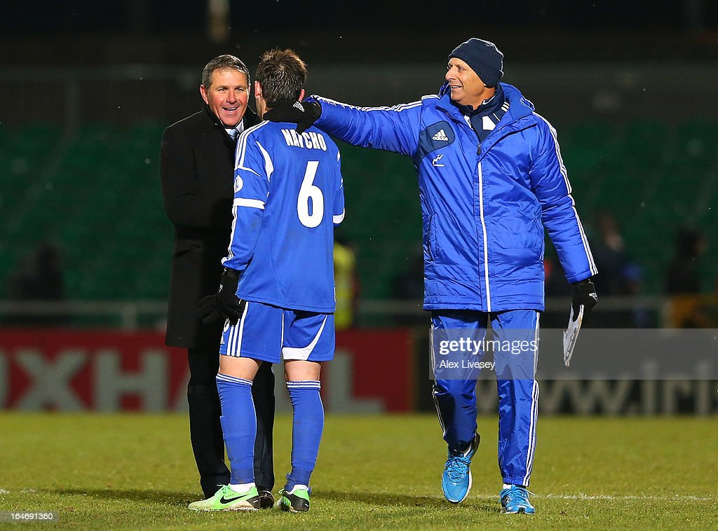 Eli Guttman the coach of Israel celebrates with Bibars Natcho after the FIFA 2014 World Cup Group F Qualifier match between Northern Ireland and Israel at Windsor Park on March 26, 2013 in Belfast, Northern Ireland.